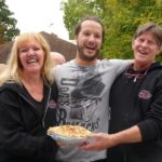 Winner of the adult Pie Eating Contest, Eddie Cullari of Warwick, finished his large apple pie in 3:17. Eddie is congratulated by Leslie Noble and Tom Hermann of Noble Pies.